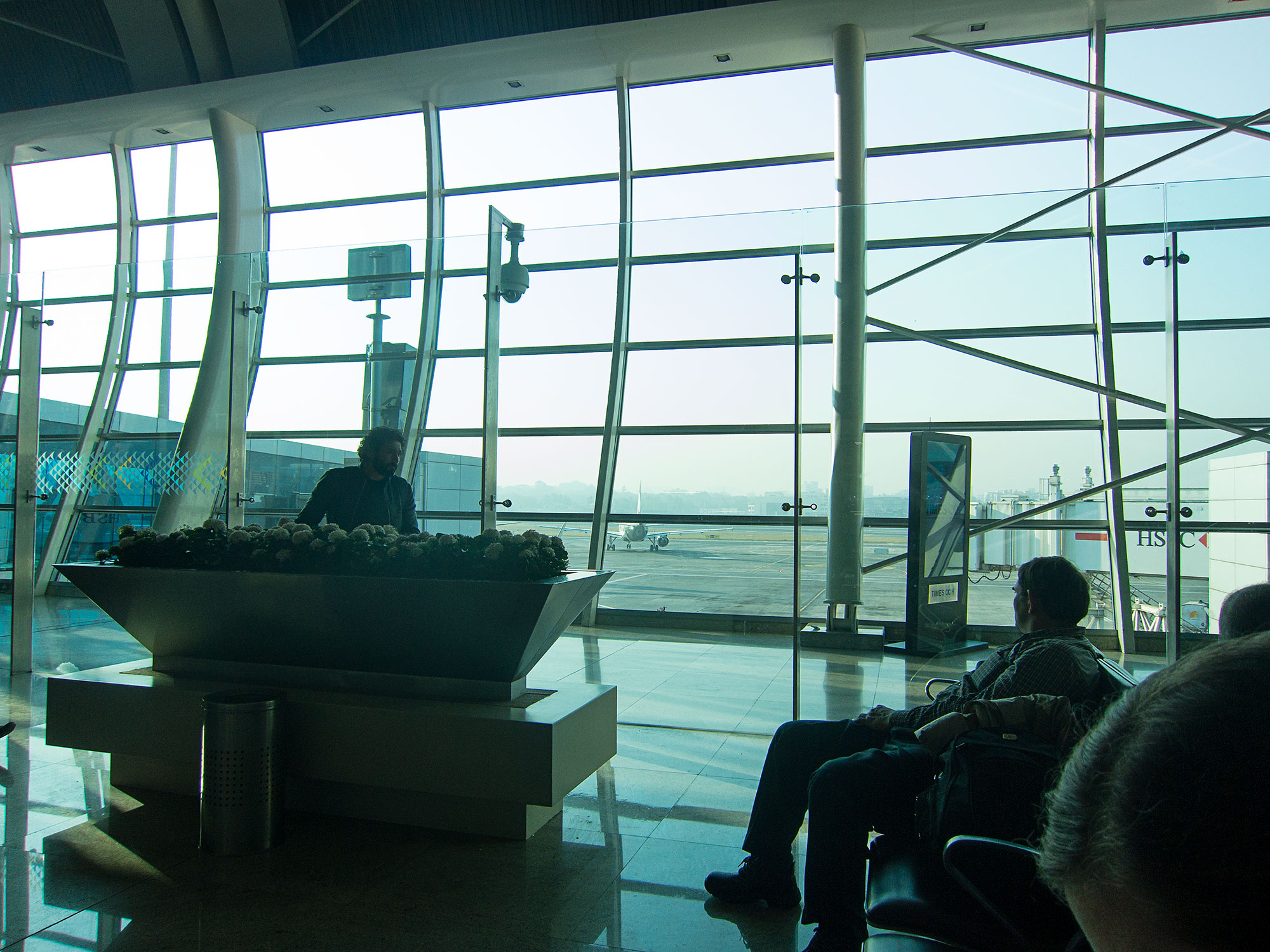 Looking out at the tarmac in the Mumbai National Airport.