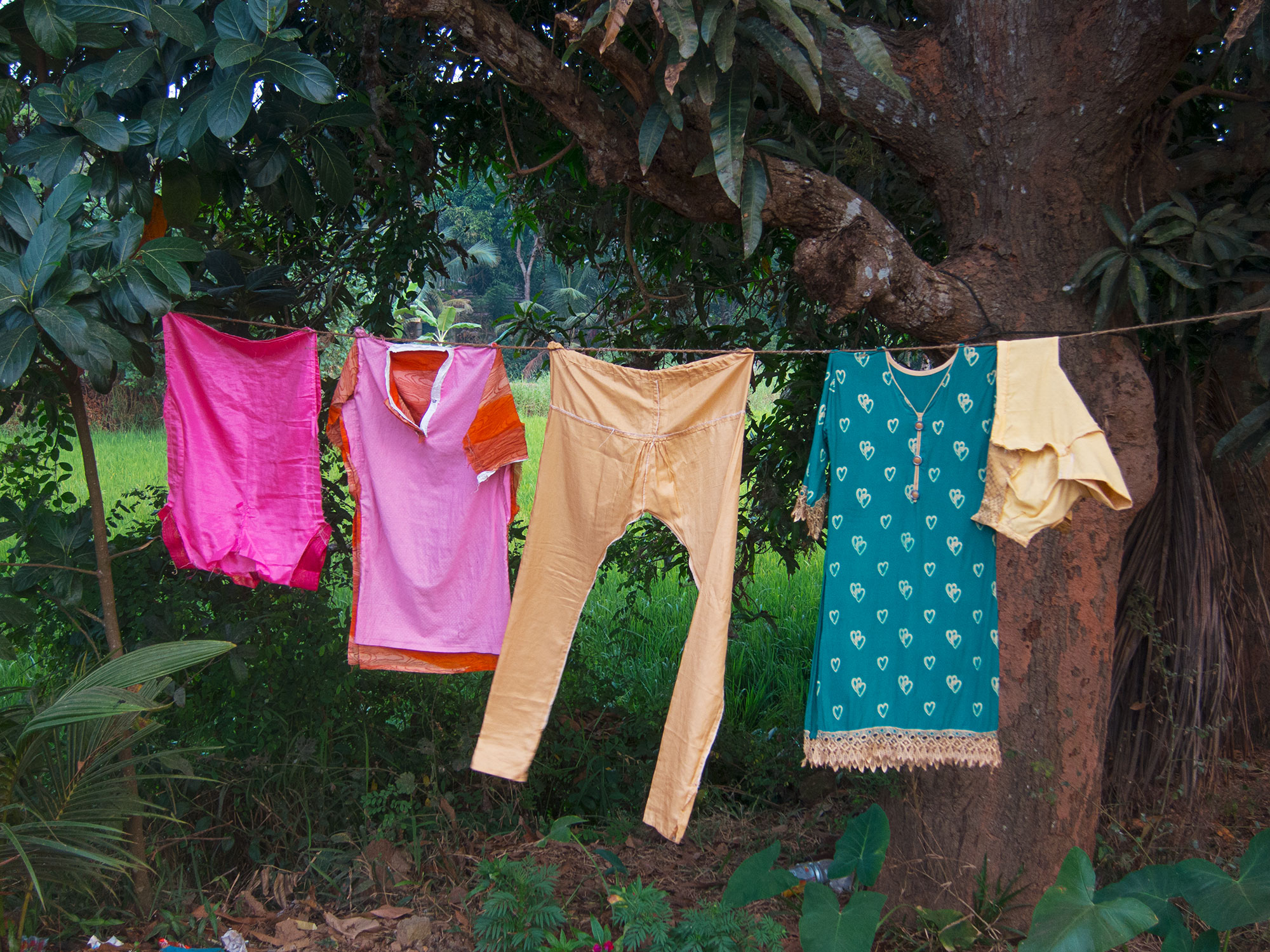 Some colorful laundry hanging up to dry.