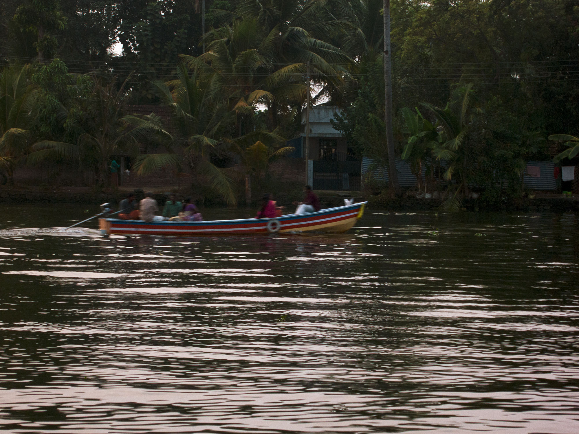 Family in a boat at dusk.