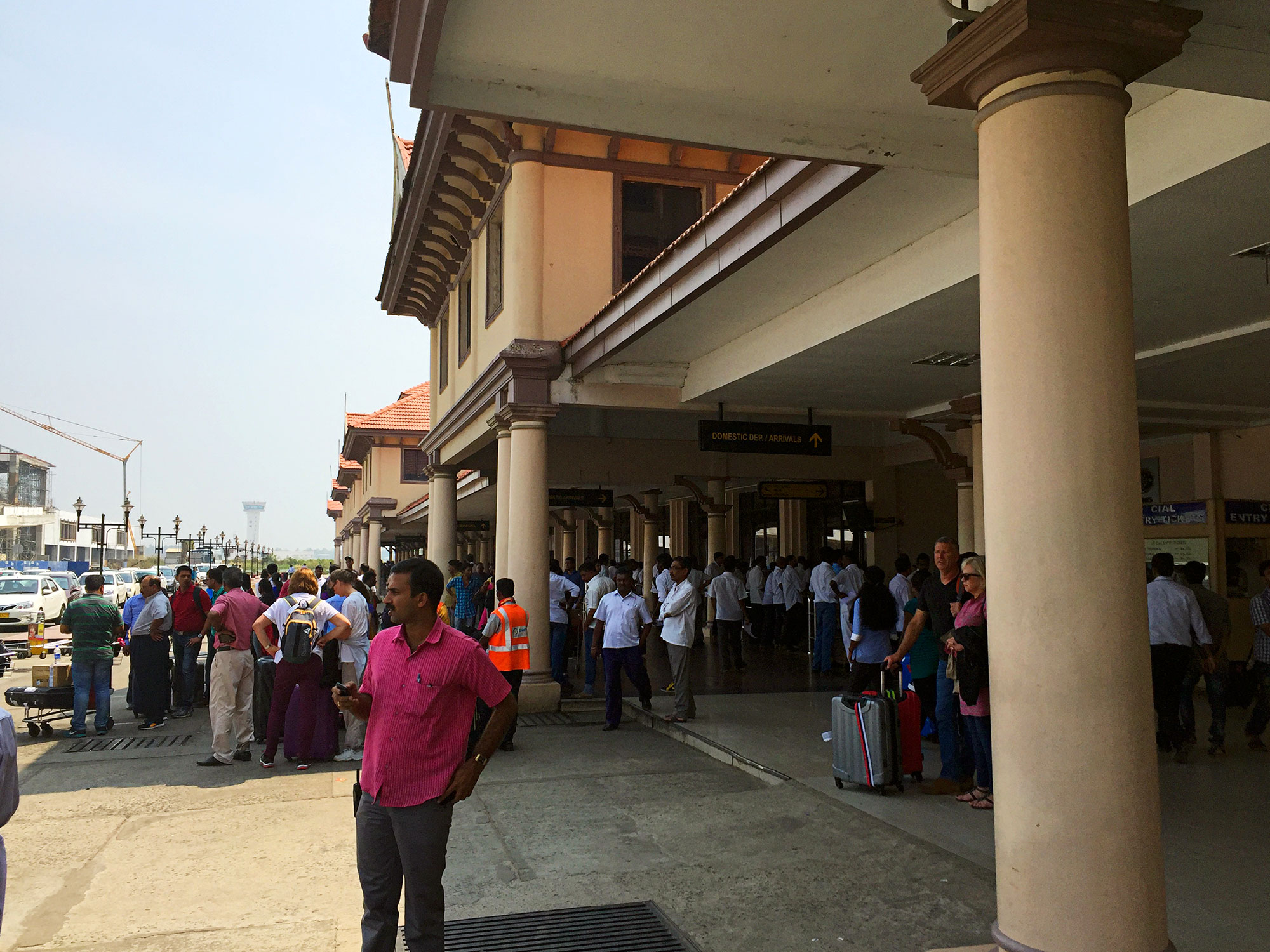 Outside the Kochi airport waiting for our driver, Rajesh, to bring the car.