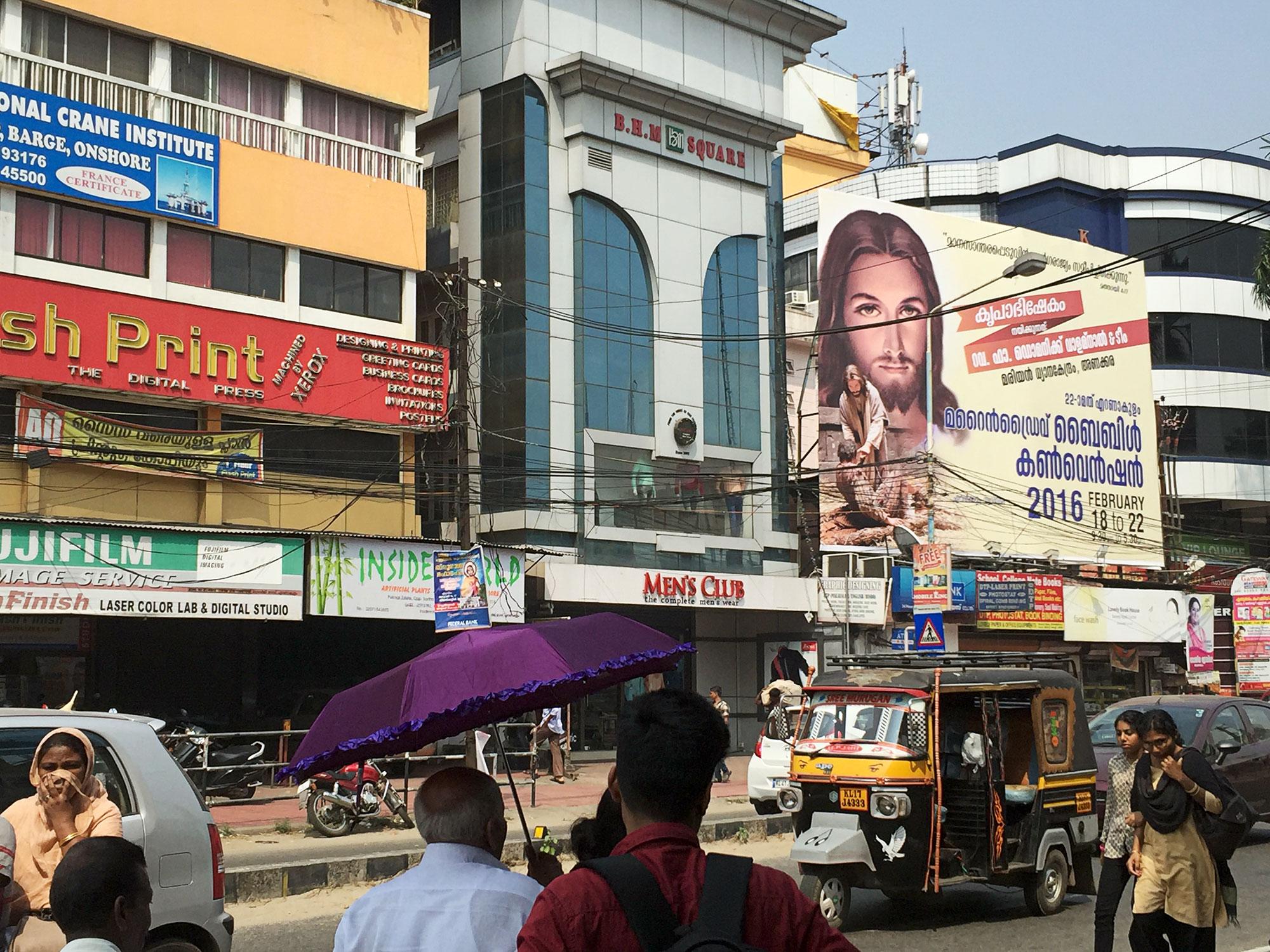 Downtown Kochi with Jesus billboard.