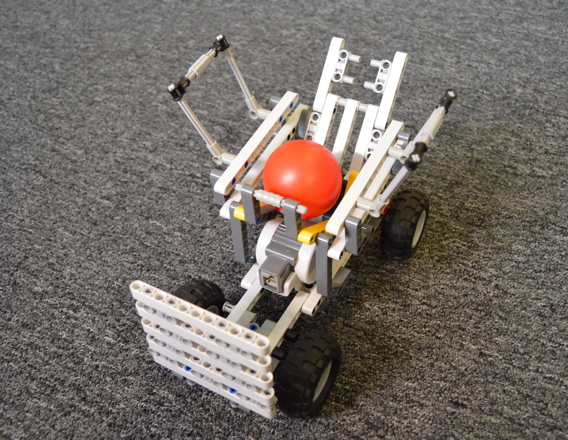 The cart with a large basket to give the best chance of catching the ball