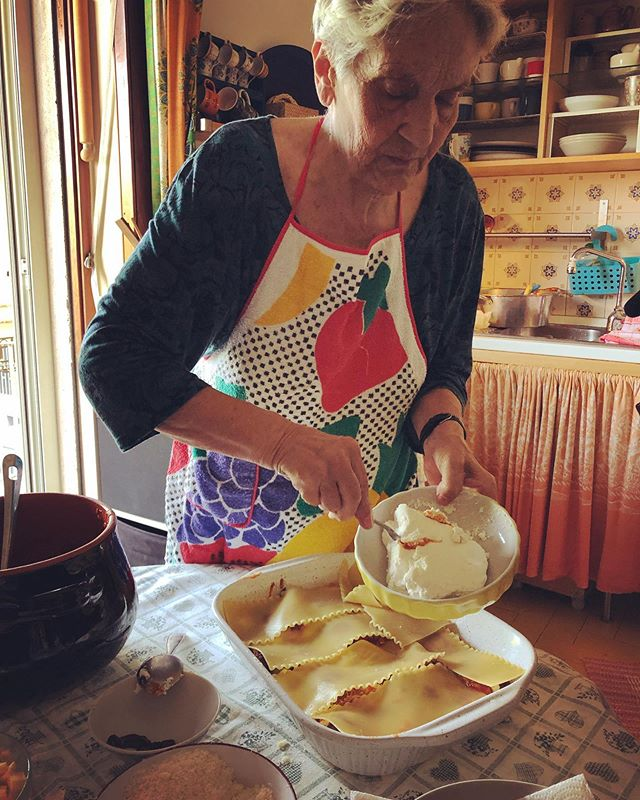 Maria Grazia made lasagna napolitana for us today: layers of pasta, ricotta, mozzarella, baby meatballs and a rich tomato sauce. This was what the Brits might call a beef stew, slowly simmered for 3 hours. The meat is fished out and served as the main course, with a plate of peeled and fried peppers, garlic, capers and olives. Her Neapolitan mother in law taught her the recipes when she got married and moved from Milan 50 years ago. #pastagrannies #ontheroad #naples
