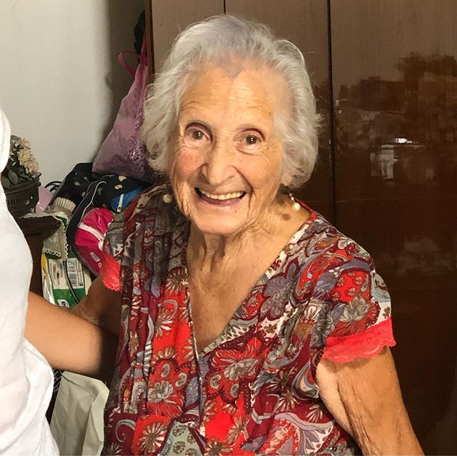 Nearly 96 year old Feni (short for Filomena) who lives on her own up a perilous flight of stairs. She made pizza con escarole for us, actually a kind of fried pie. Second pic is 5'10 cameraman Andrea towering over her as she worked. 3rd pic, note the scissors to cut the dough. She was a seamstress; her husband made beautiful handbags and she made the linings. More about this lovely woman soon. #pastagrannies #ontheroad #procida