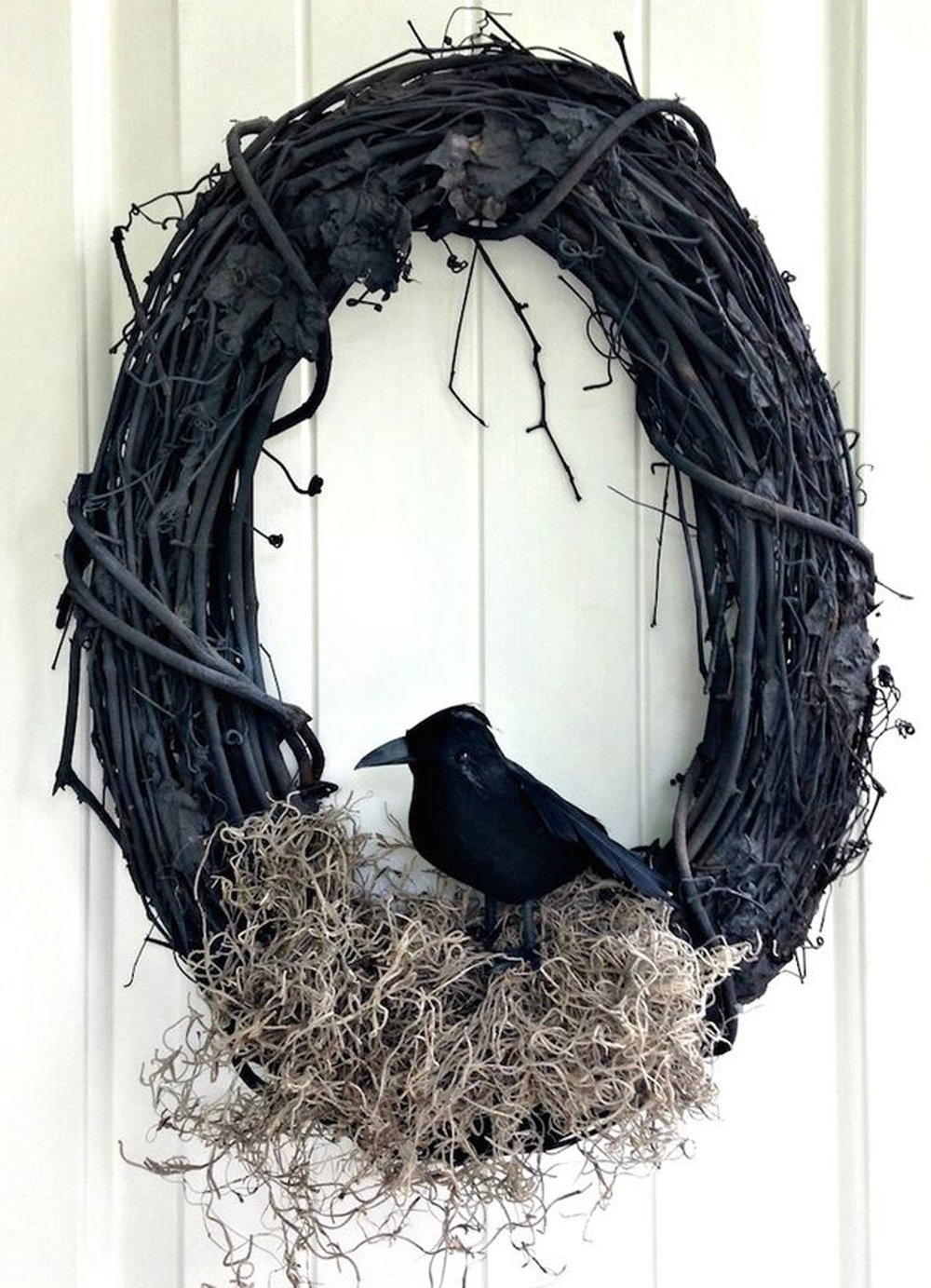 Transform a traditional wreath into a creepy one with this easy as (crow) pie DIY (via Bloglovin')