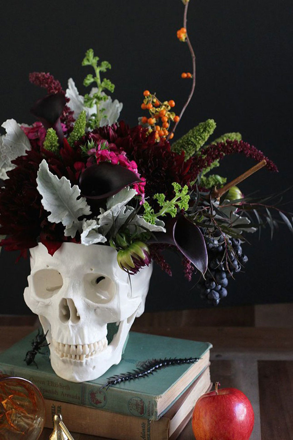 Pair skulls and a dark floral arrangement for an eerie glamour (via Brit + Co)