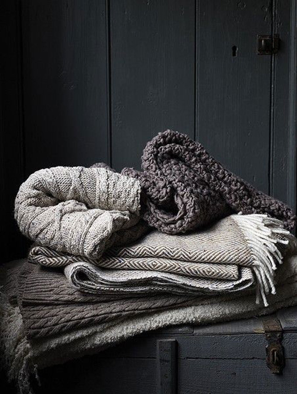 Warm up with chunky knits in shades of gray for the ultimate cozy (via Greige Design)