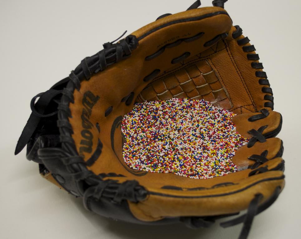 Glove 2013 Child's baseball glove, non-pareils, plaster, epoxy, wool.