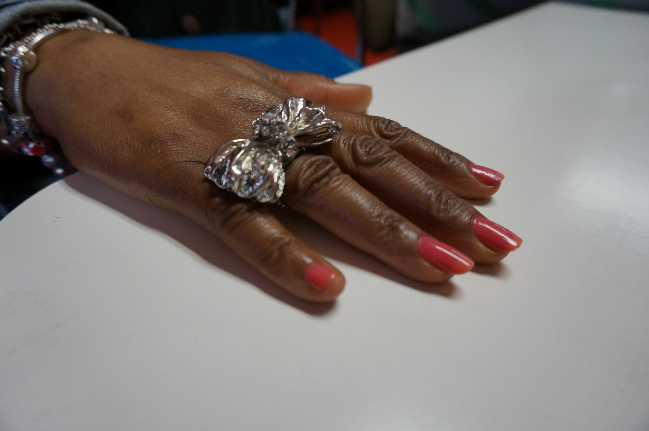 My mother wanted me to take a picture of her ring and nails lmao!