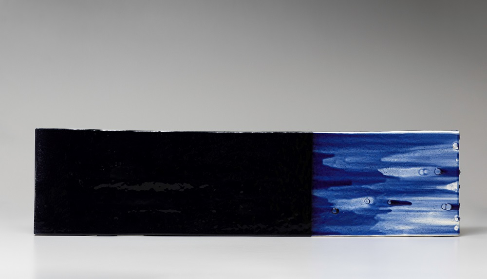Untitled, 2019, glazed ceramics, 11 x 45 x 2 3/4 inches.