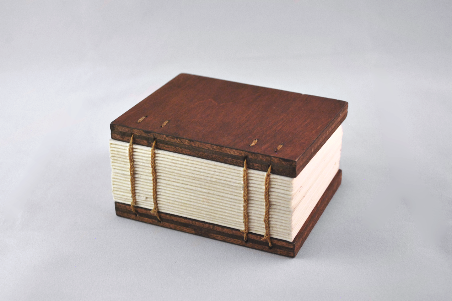 Coptic Stitch Books - My favorite binding! Great for guestbooks and photo albums because they lay flat. Exposed spine is a nice design feature.