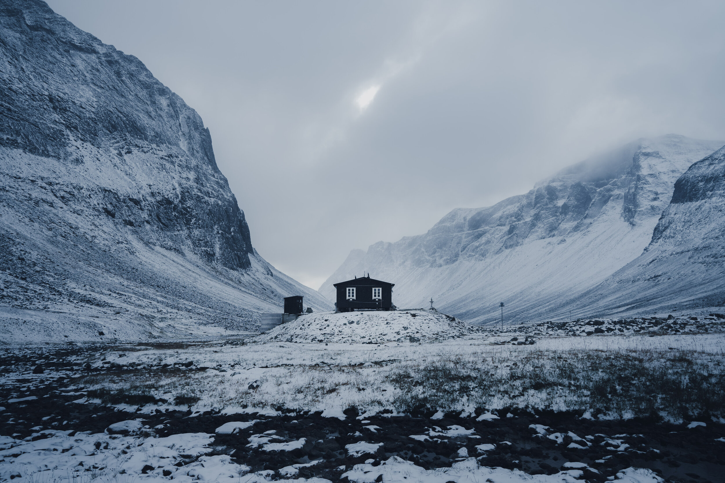 The Nallo hut looking small below the steep mountain sides.