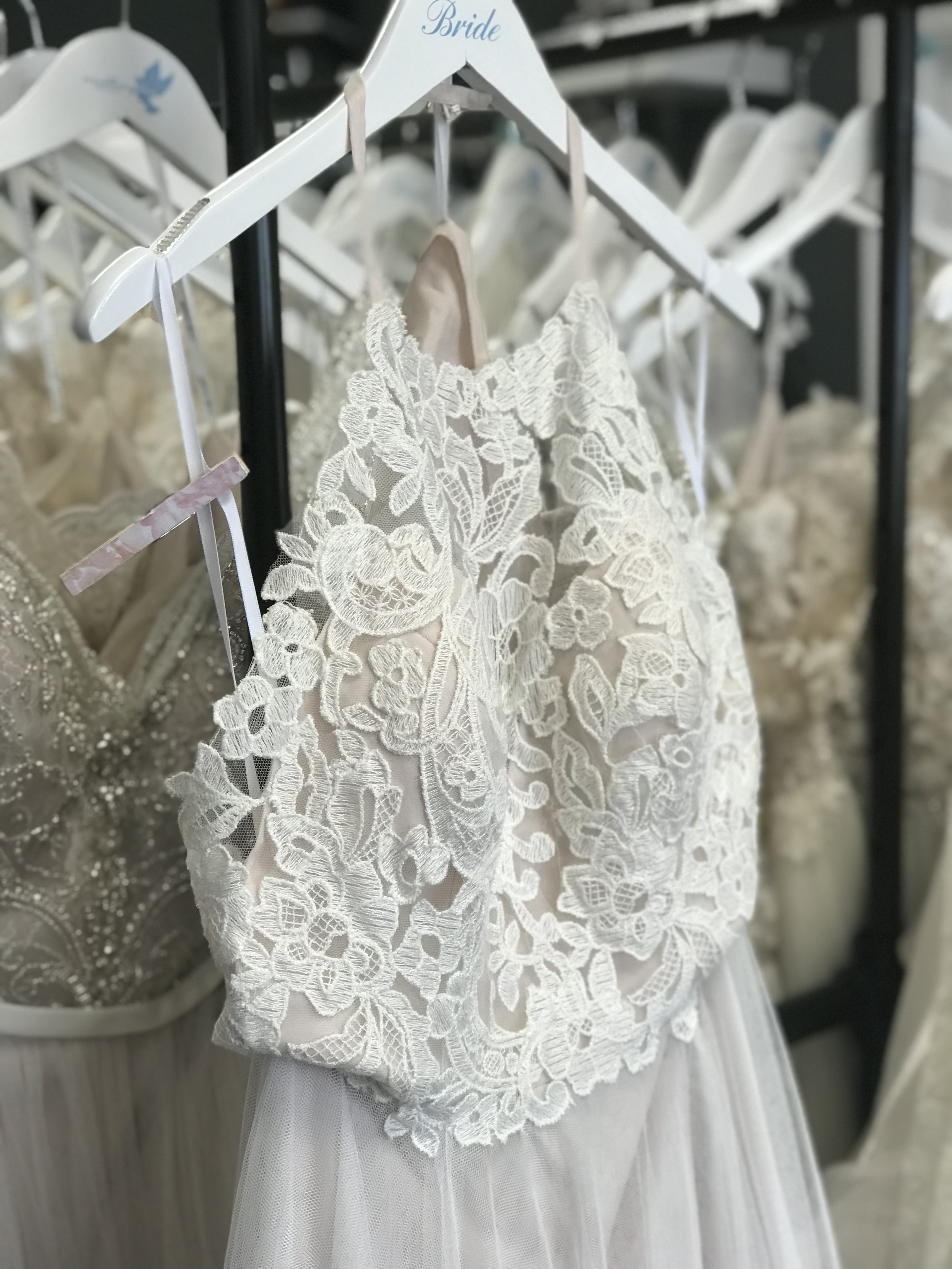 After we give you a tour of the boutique, you will be given pins so you can mark each dress you want to try on! Your consultant will grab the gowns you pin and bring them to your fitting room.