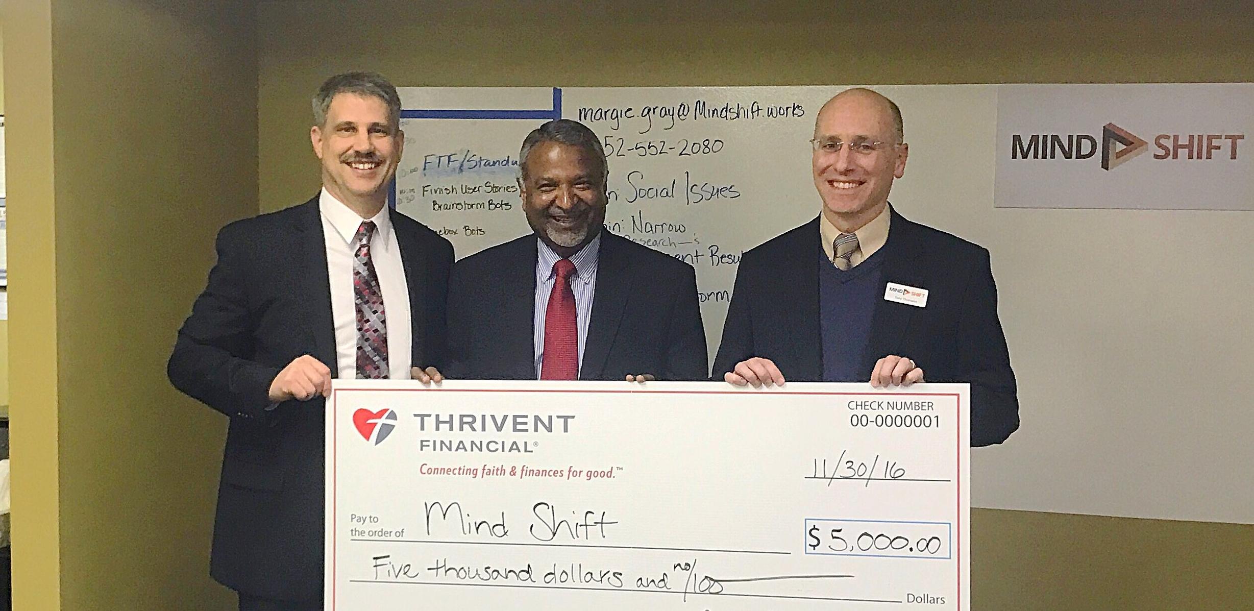 Mike Paulson and Prakash Mathew present Mind Shift's Tony Thomann, with the big check!
