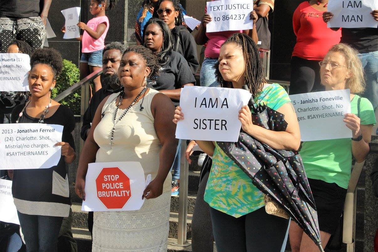 Rolanda Byrd, PACT Executive Director, on the left, at a demonstration at the Wake County Justice Center.