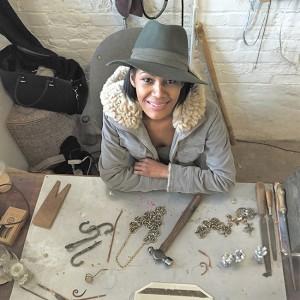 Billie Hilliard sitting pretty at her work desk in her studio.