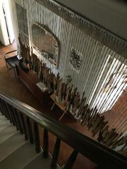 Piano keys strung next to the staircase