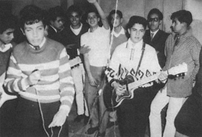 """This photo is from an excellent resource on Mexican Rocanrol titled Refried Elvis: The Rise of Mexican Counterculture.   http://publishing.cdlib.org/ucpressebooks/view?docId=ft5q2nb3w6;brand=ucpress   Scores of Mexican bands emerged by the early 1960s to meet the de-mand for rocanrol, as in this unidentified photograph, probably taken at a privateparty. Source: """"Concentrados: sobre 2206, 'Rock and Roll,' n.d.,"""" Hermanos MayoPhoto Archive, Archivo General de la Nación. Used by permission."""