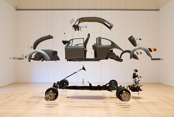 "Damian Ortega, ""Cosmic Thing"" (2002) Disassembled 1989 Volkswagen Beetle, 265x296 in, The Museum of Contemporary At, Los Angeles, purchased with funds provided by Eugenio Lopez and the Jumex Fund for Contemporary Latin American Art. (image courtesy ICA/Boston)"