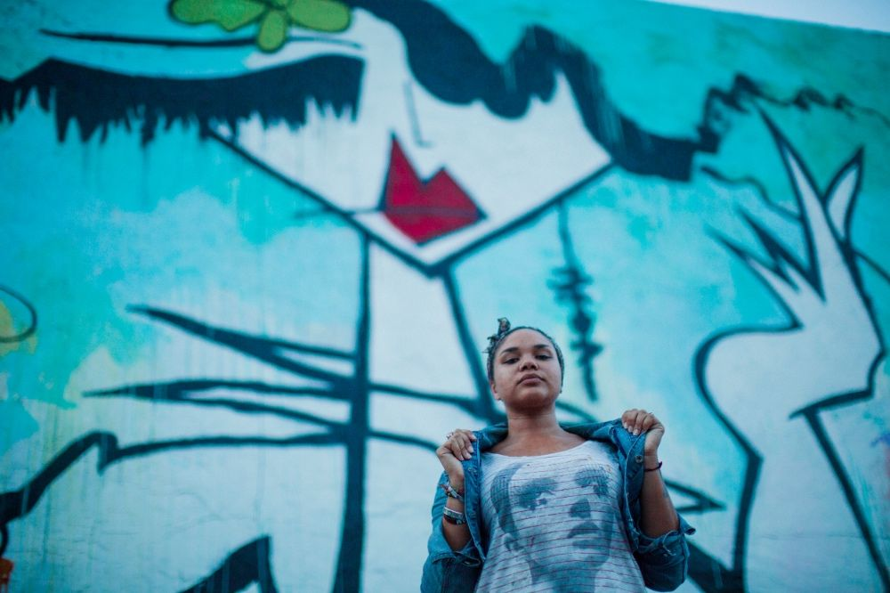 Photo by Nate Robinson: Graffiti artist Jenny Perez in front her Wynwood Mural near Panther Coffee.