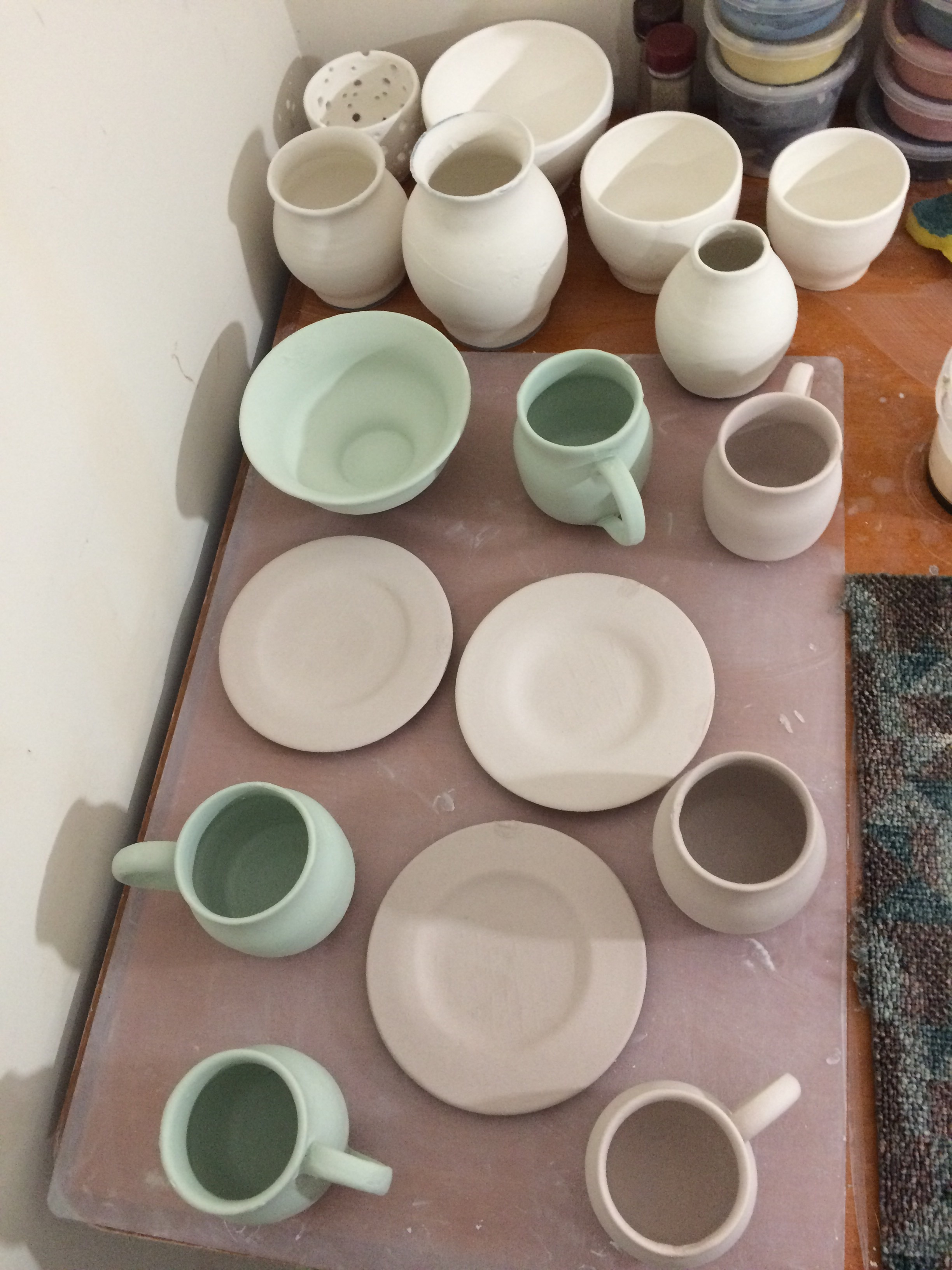 The glaze sets on the pots in certain colours but this does not indicate what colour they will be when they are fired!