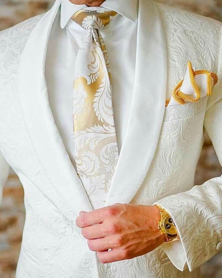 white pattern fabric, white lapel with gold accessories
