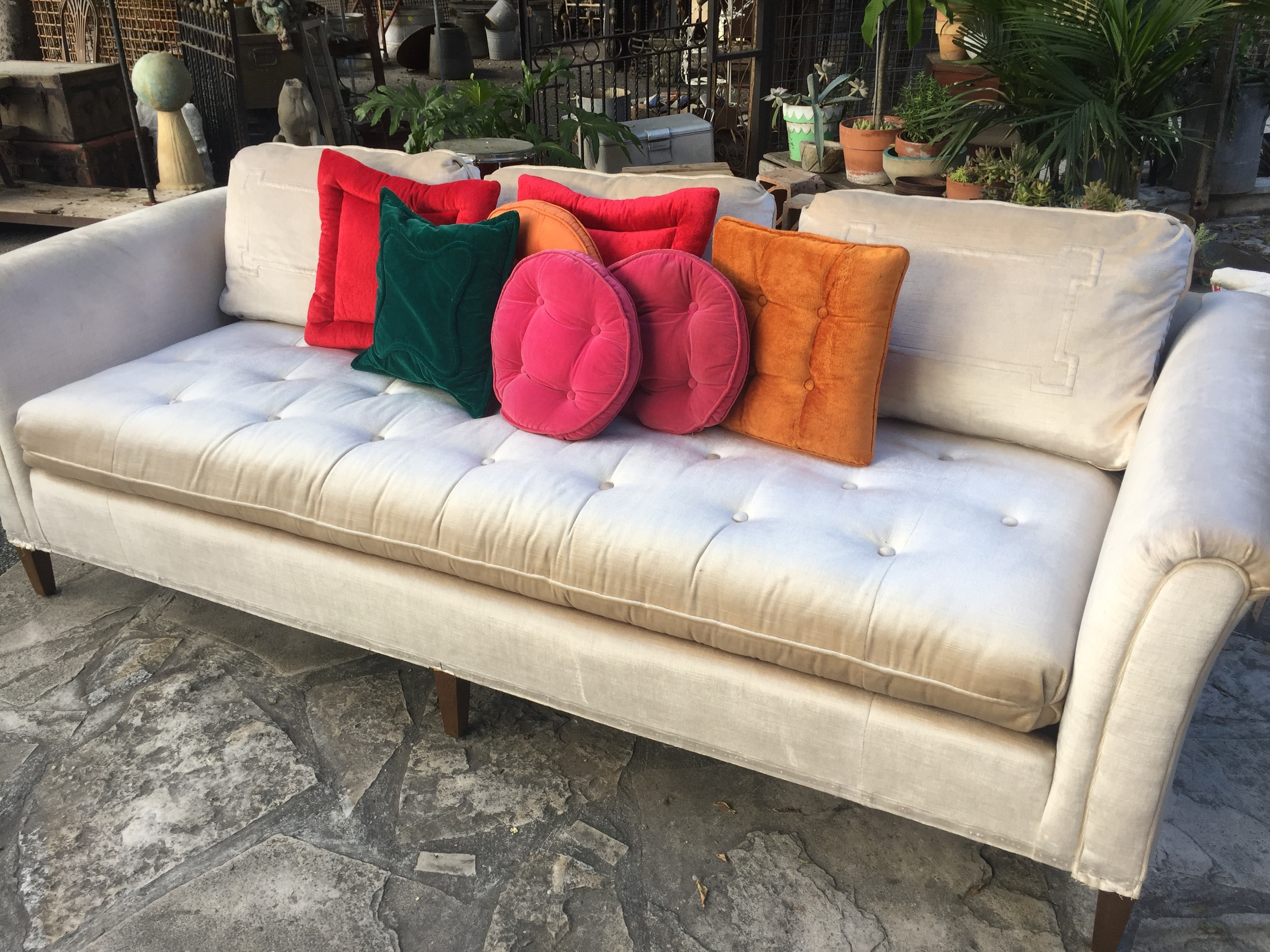 With a pop of colorful pillows.