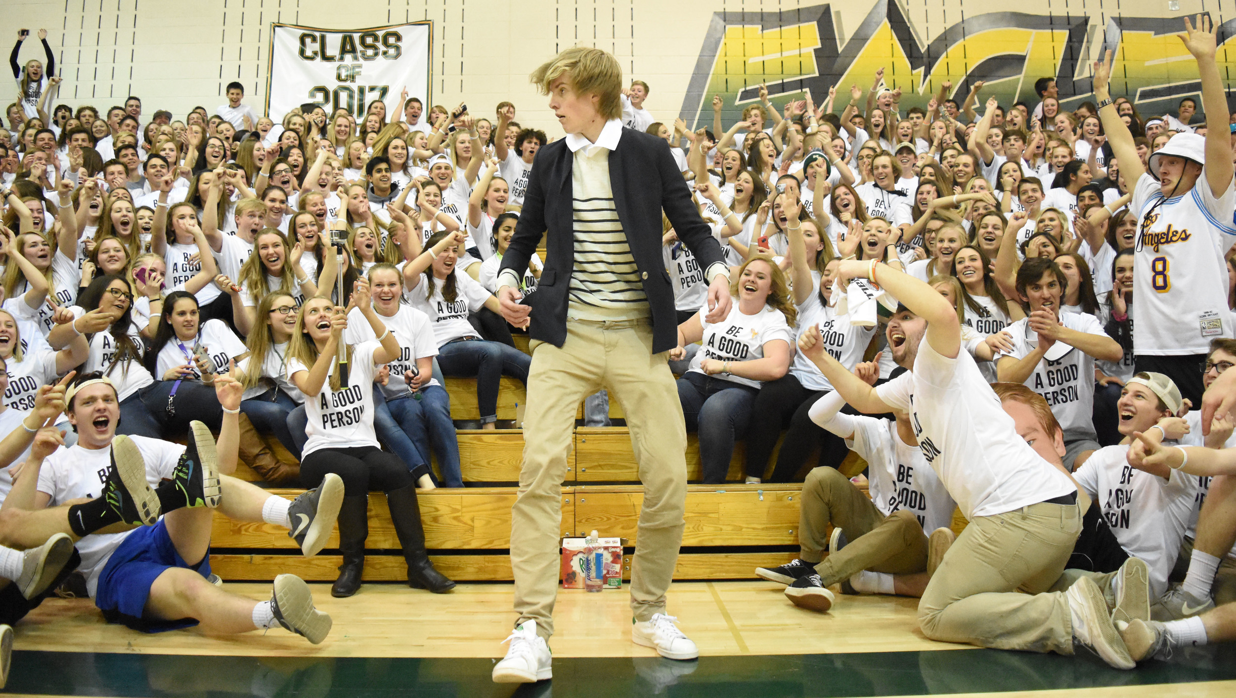 Senior Ben Holland emerges from the back of the Mountain Vista student section dressed like Ellen DeGeneres to shade the ThunderRidge students, who attempted to get Ellen to join in the school's Field Day activities in 2015, during halftime of the rivalry basketball game.