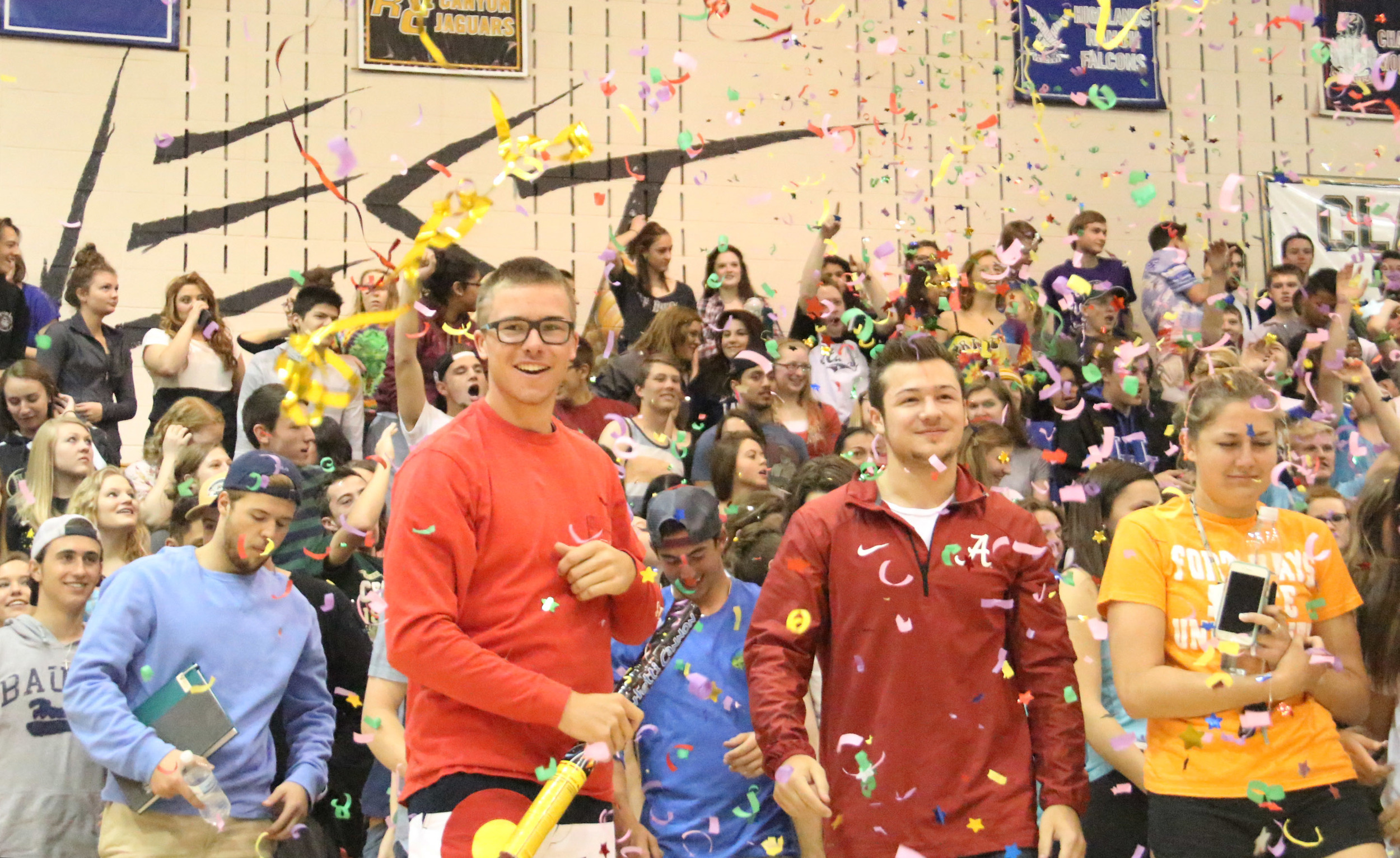 Seniors Brady Subart and Jake Varra look at the Mountain Vista gym one last time during the moving up assembly that serves as a send off for the senior class.