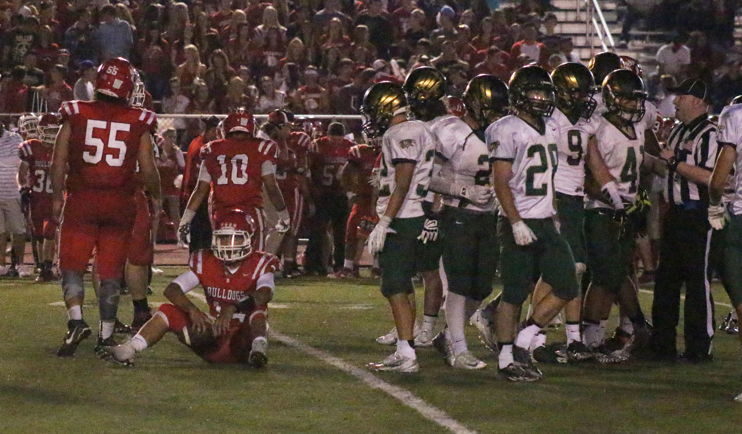 Brighton's quarterback, senior Brady Jacovetta, sits on the floor after a 10-yard sack by Mountain Vista senior Matt Yockey prevented the Bulldogs from reaching a first down.