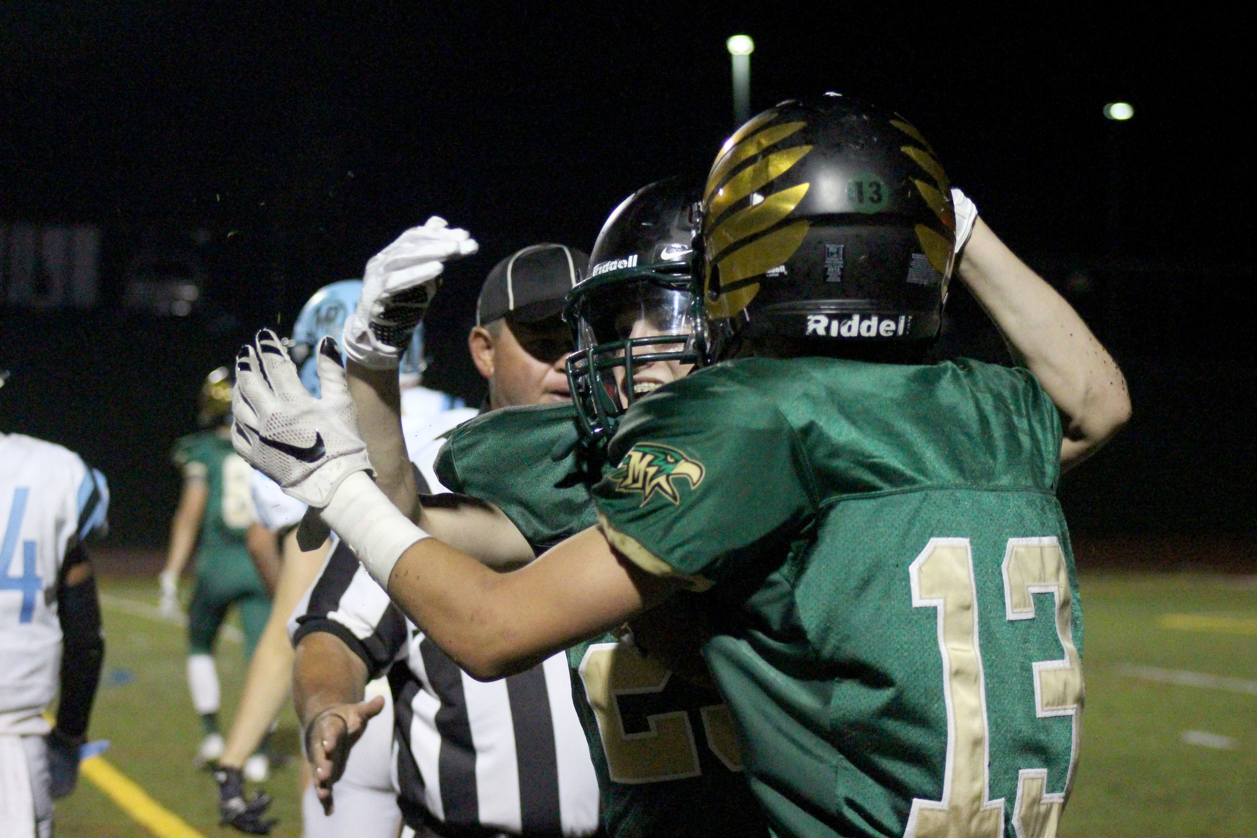 Juniors John Krysa and Tristan Dean celebrate a touchdown during the Mountain Ridge, Mountain Vista football game.  Dean was accountable for two of the night's five touchdowns.