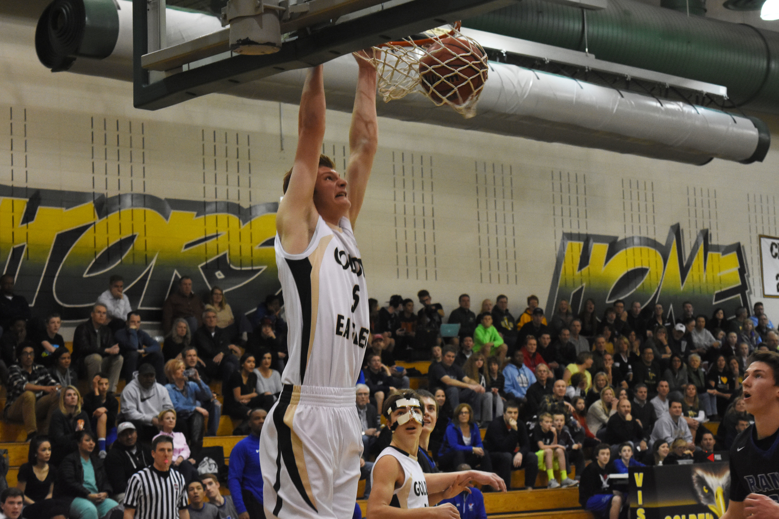 Junior Jake Belknapp dunks on Highlands Ranch during the first period.