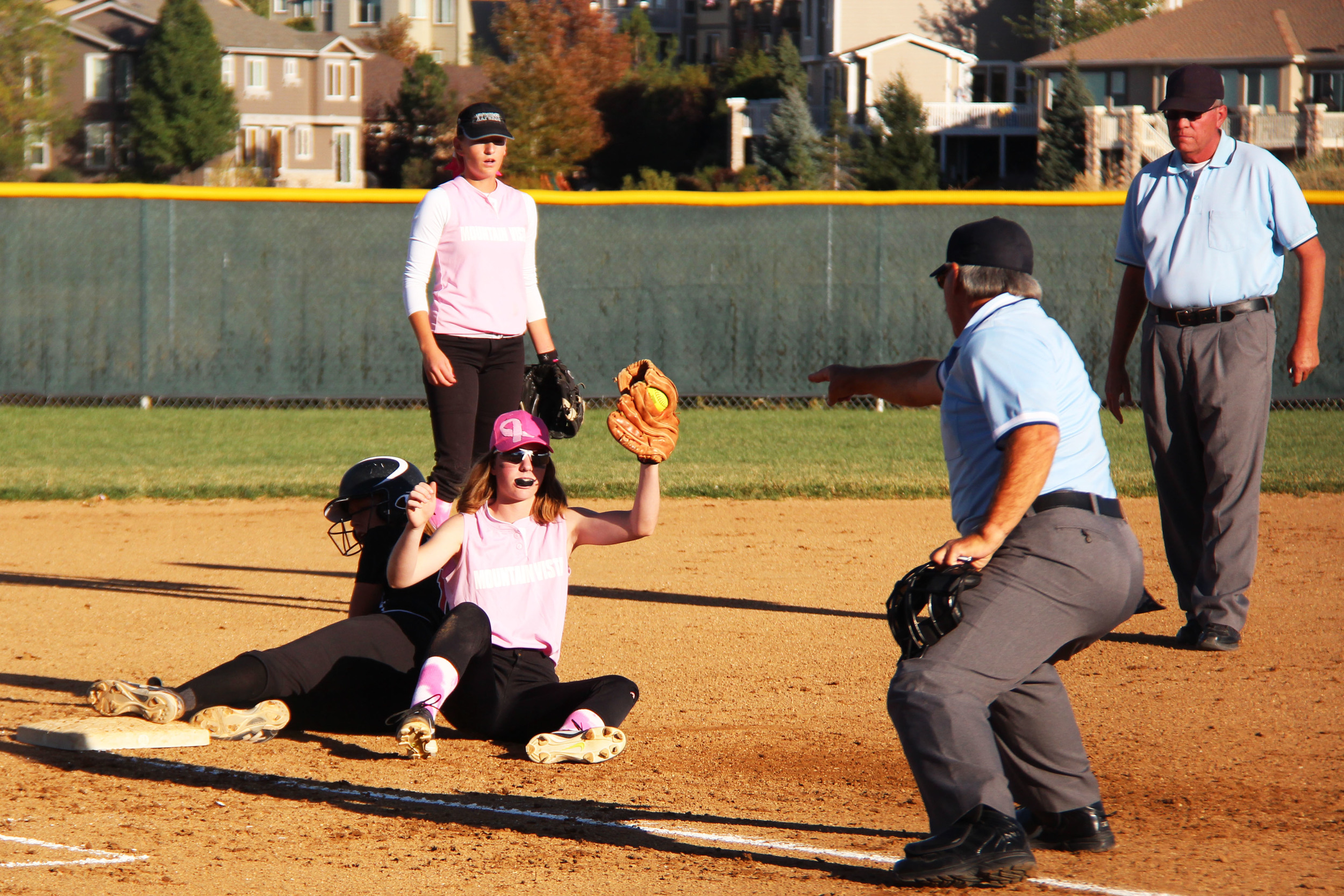 Sophomore Kyla Dezell holds up her glove as proof of possession after tagging a runner out.