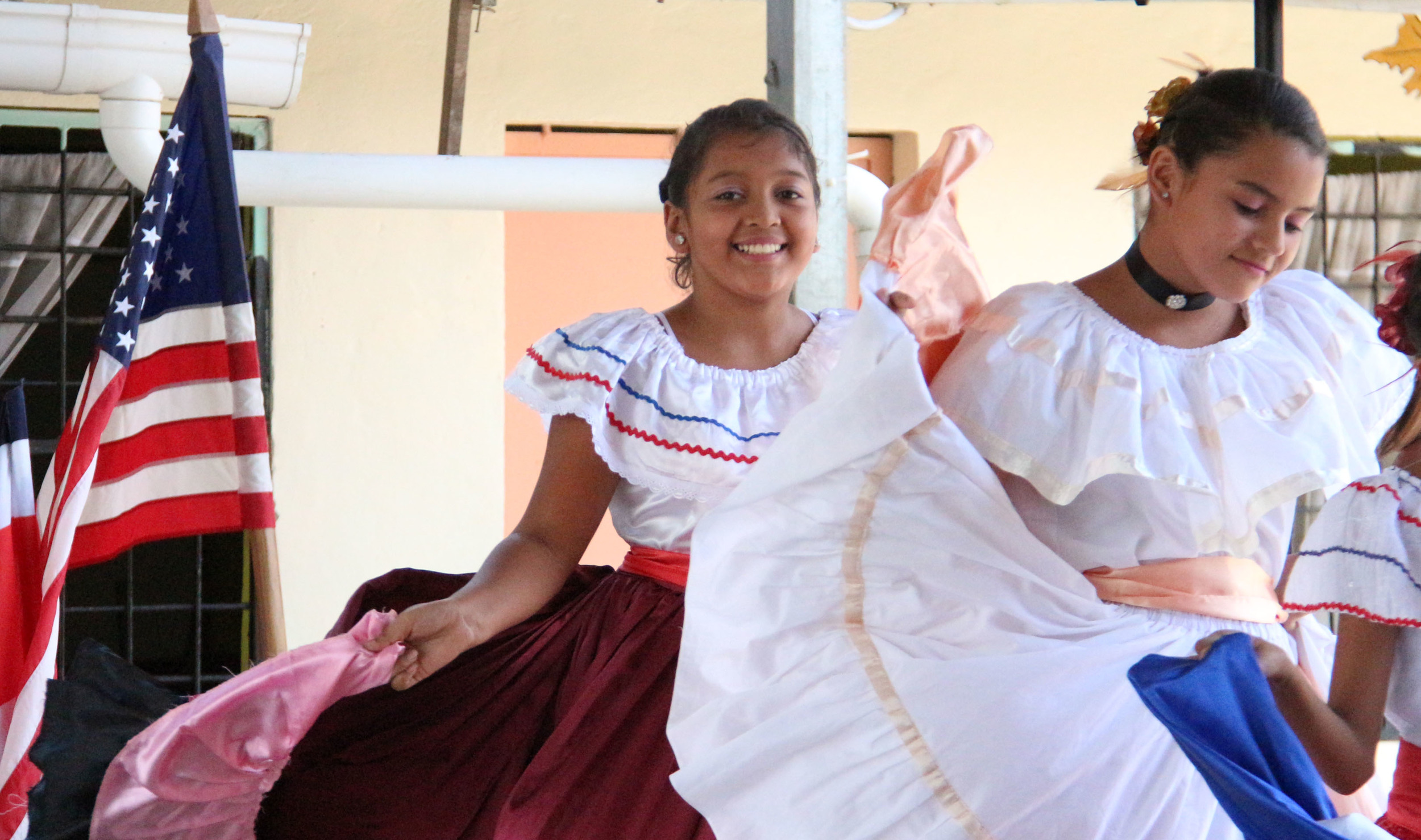 "One student smiles on as a class performs a traditional Costa Rican dance for Mountain Vista students. After they were finished, MV was asked to perform as well. ""It was really cool to immerse myself into a different culture,"" junior Marisa Deconza said."