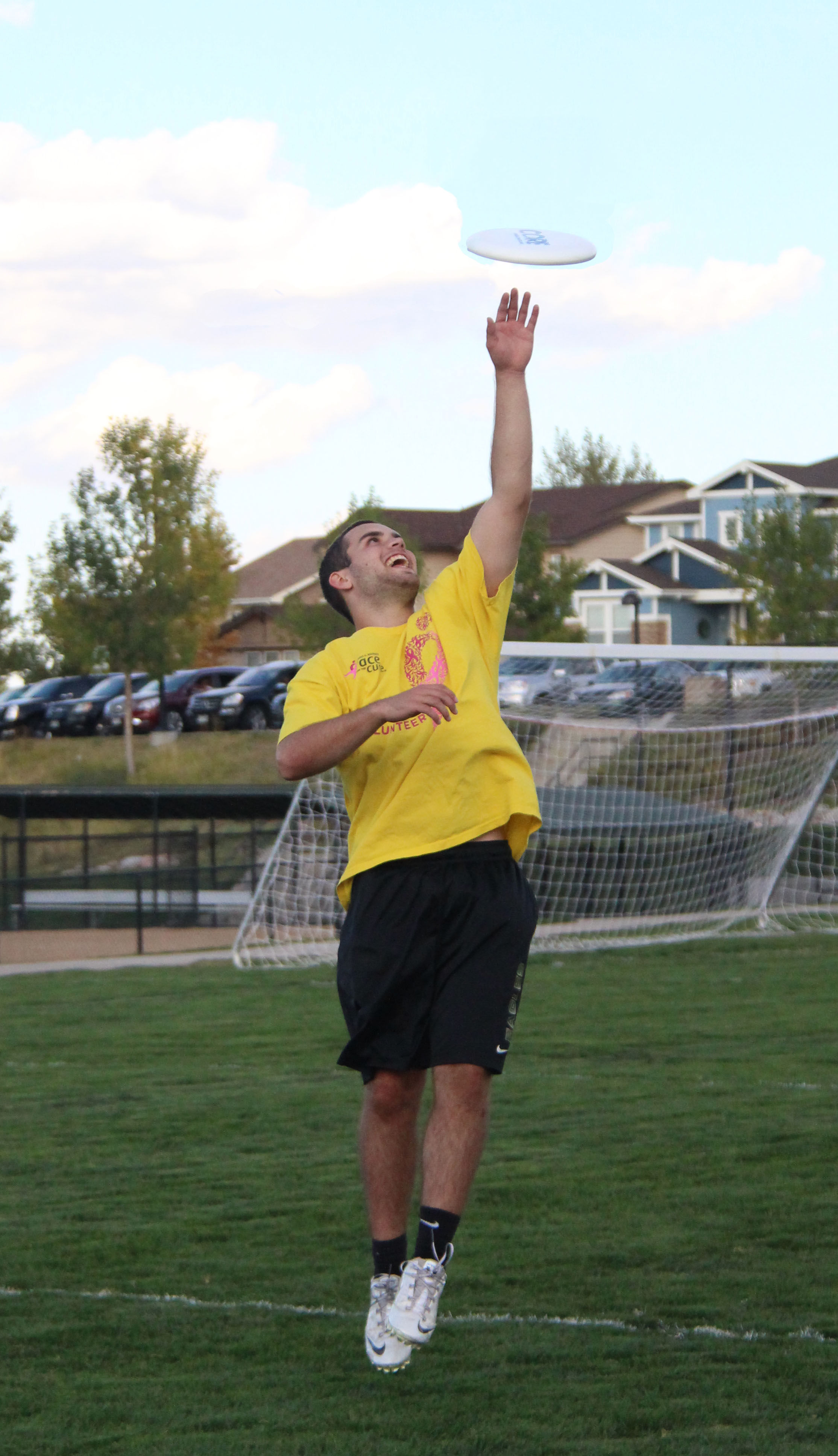 Senior John Harris reaches up to grab a toss from a fellow teammate during Ultimate Frisbee practice. The 2015-2016 season marked the first year that the team competed against other schools.