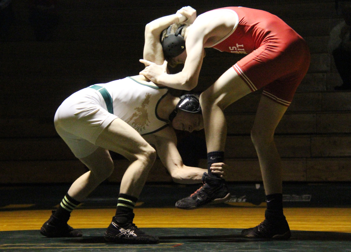 Junior Justin Schroeder competes in a wrestling match against Heritage High School.