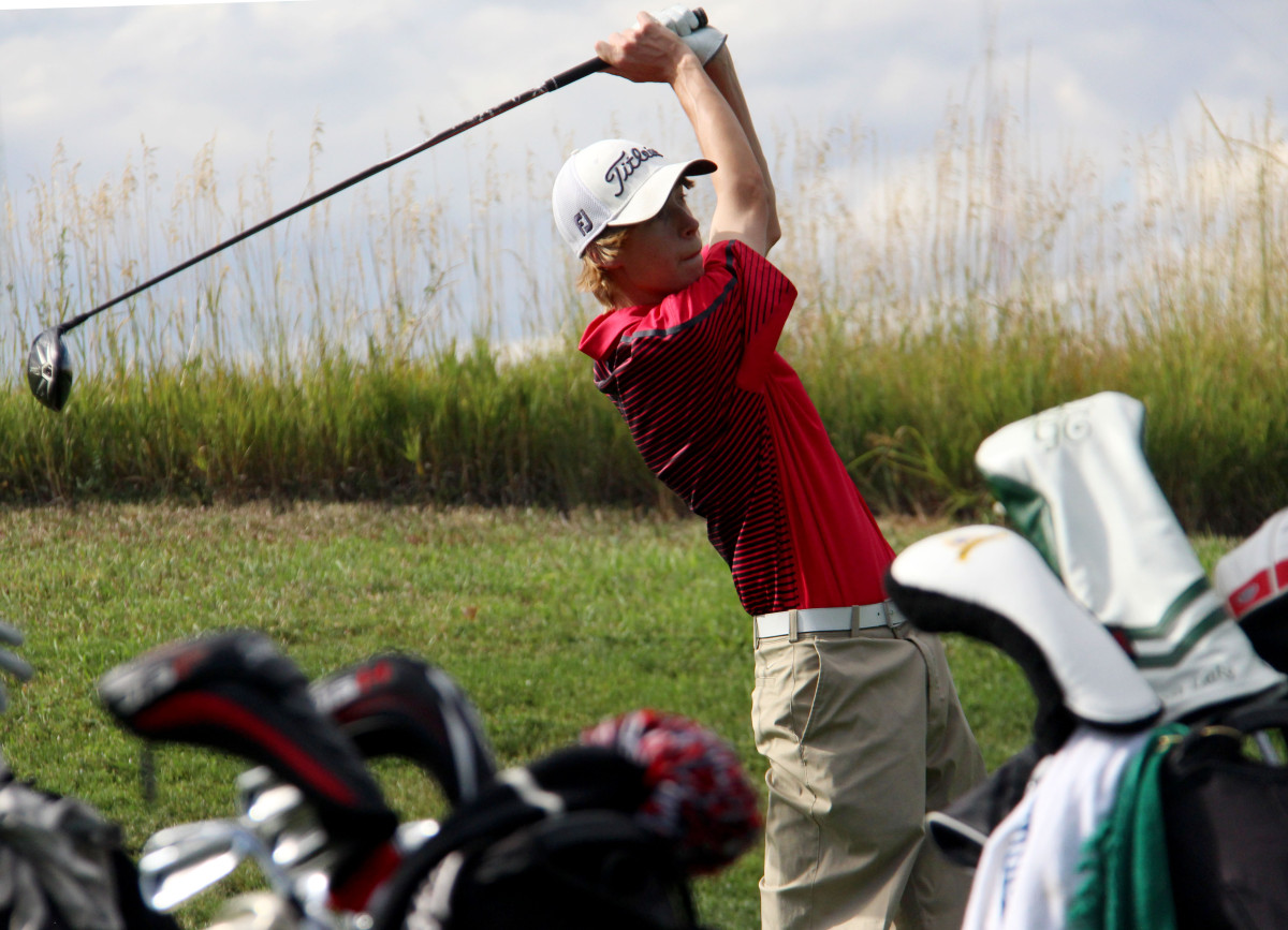 Senior Cameron Chapman tees off during practice at the Links. Chapman was one of the four qualifying players for the state team, which took eighth overall.
