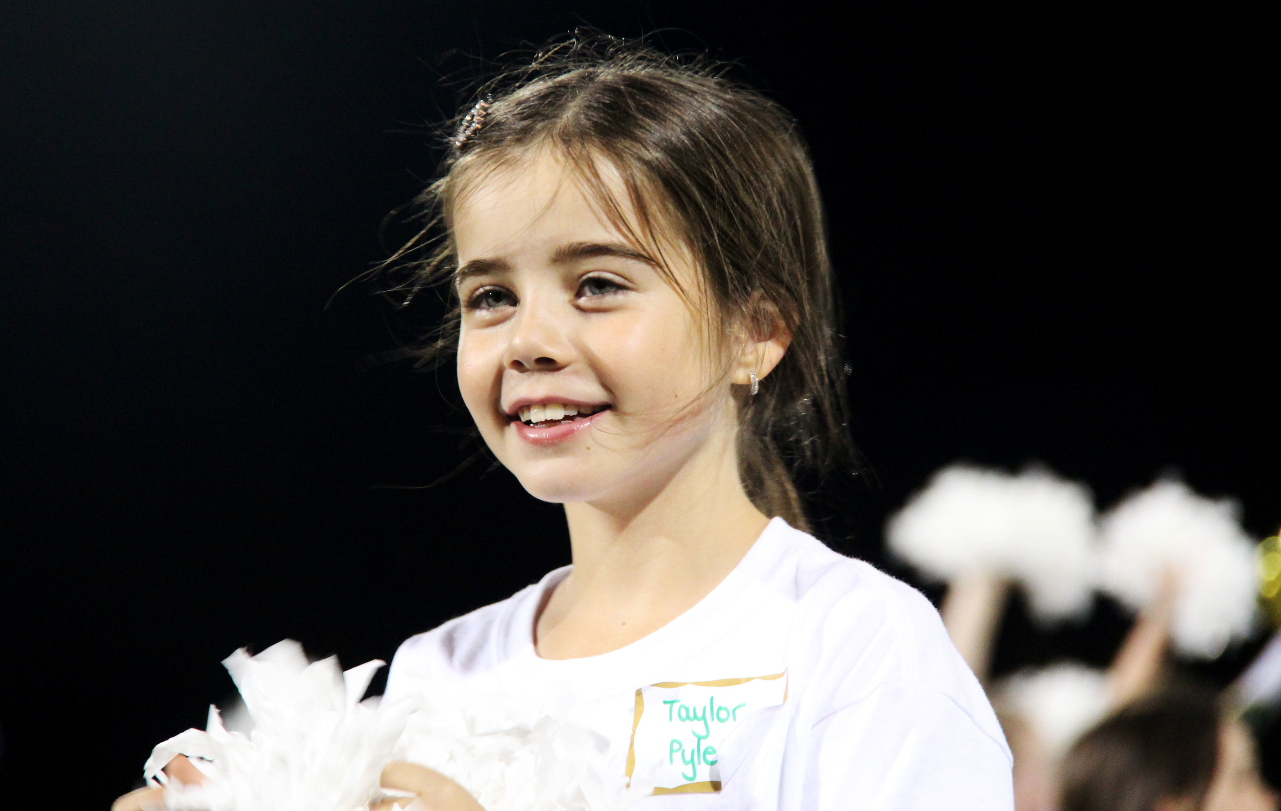 A student poms dancer performs at halftime of the Mountain Vista, ThunderRidge rivalry football game.