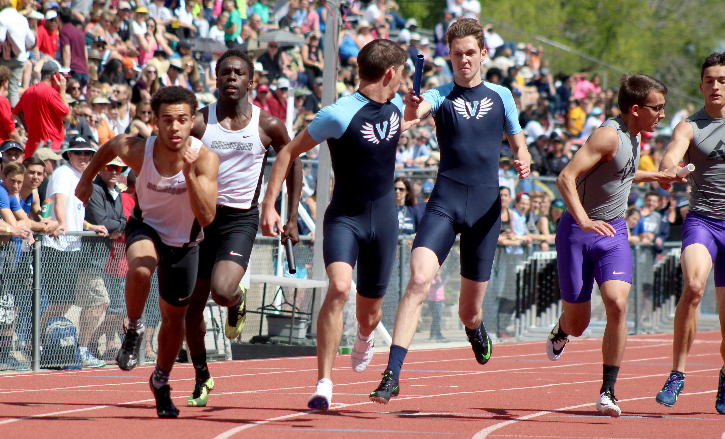 Senior Hunter Dagnon of Valor Christian hands off the baton to junior Chase McLean during the 4x200 relay race. Dagnon, McLean and seniors Christian Barber and Ben Waters clocked in at 1:27.57.  Published May 2016, Highlands Ranch Herald