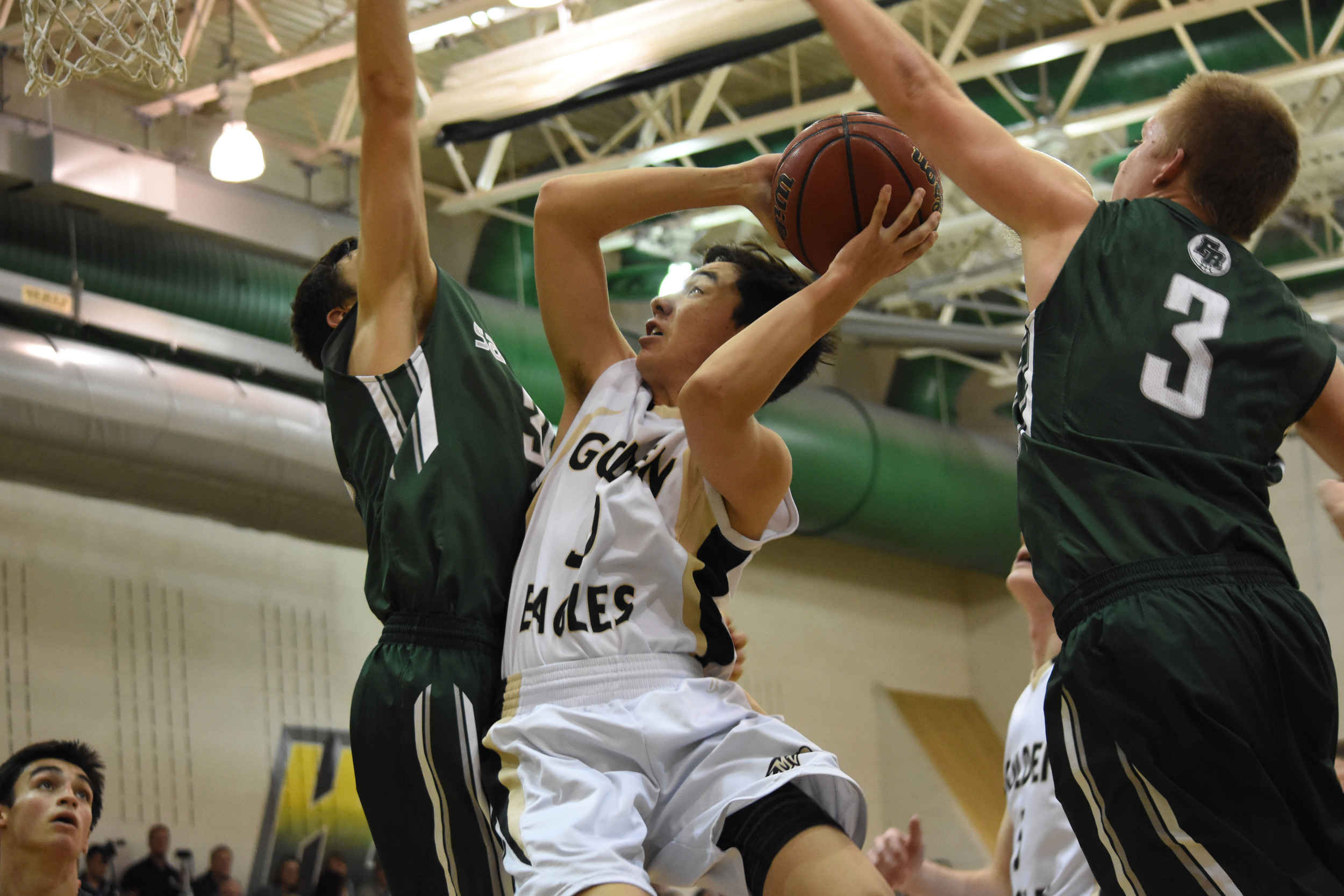 Senior Joey Yamane goes up for two points during a game against Fossil Ridge High School.  Published January 2016, Vista Now