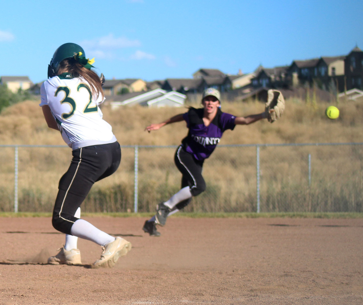 Sophomore Savanah Howard dodges a line drive hit past short while base running.  Published September 2015, Vista Now