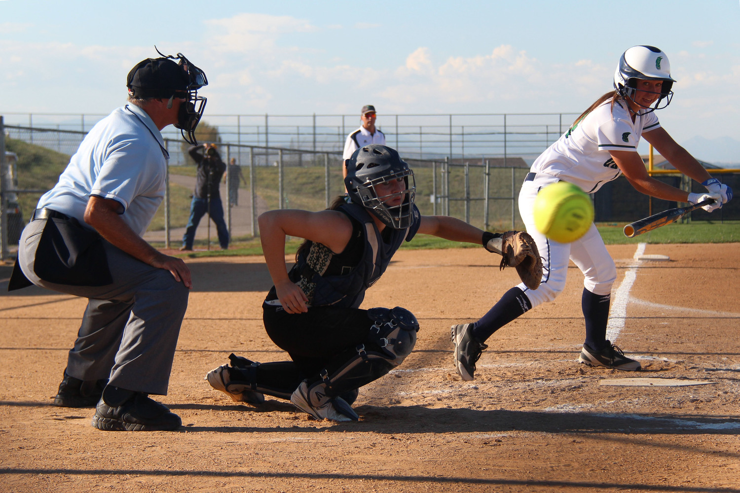 Senior Kelsey Heiland watches as a foul ball makes its way to the fence.  Published September 2014, Vista Now