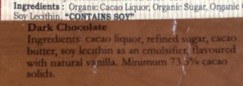 """Photo of the ingredients list on two different bars. One package states on the front """"Single Bean Origin"""". Hmmm..."""