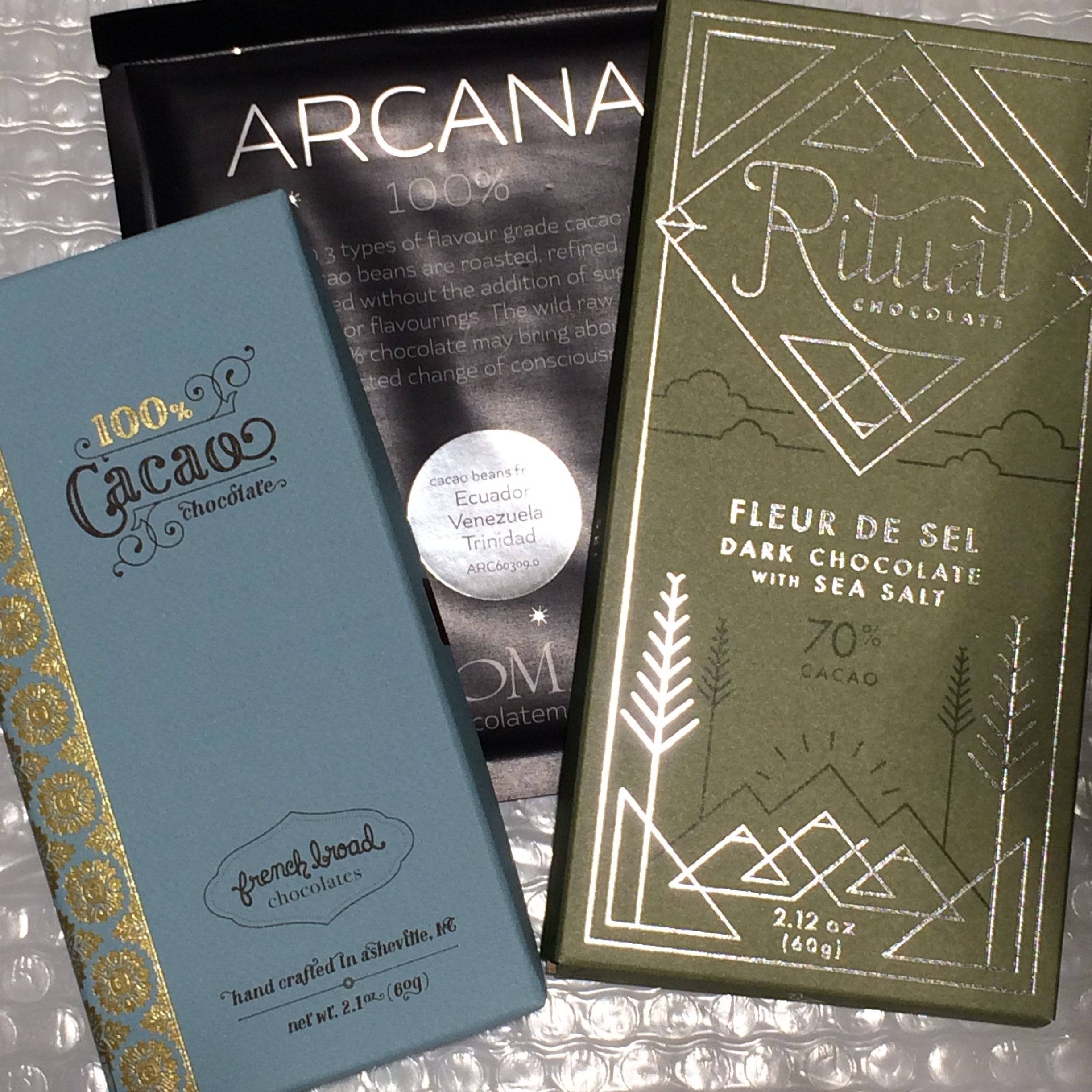 Three House Blends that we stock: French Broad and Soma's 100% cacao bars, and Ritual's Mid-Mountain Blend with Fleur de Sel.