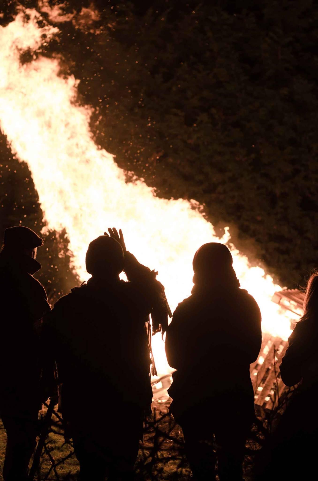 Crowding around the bonfire.