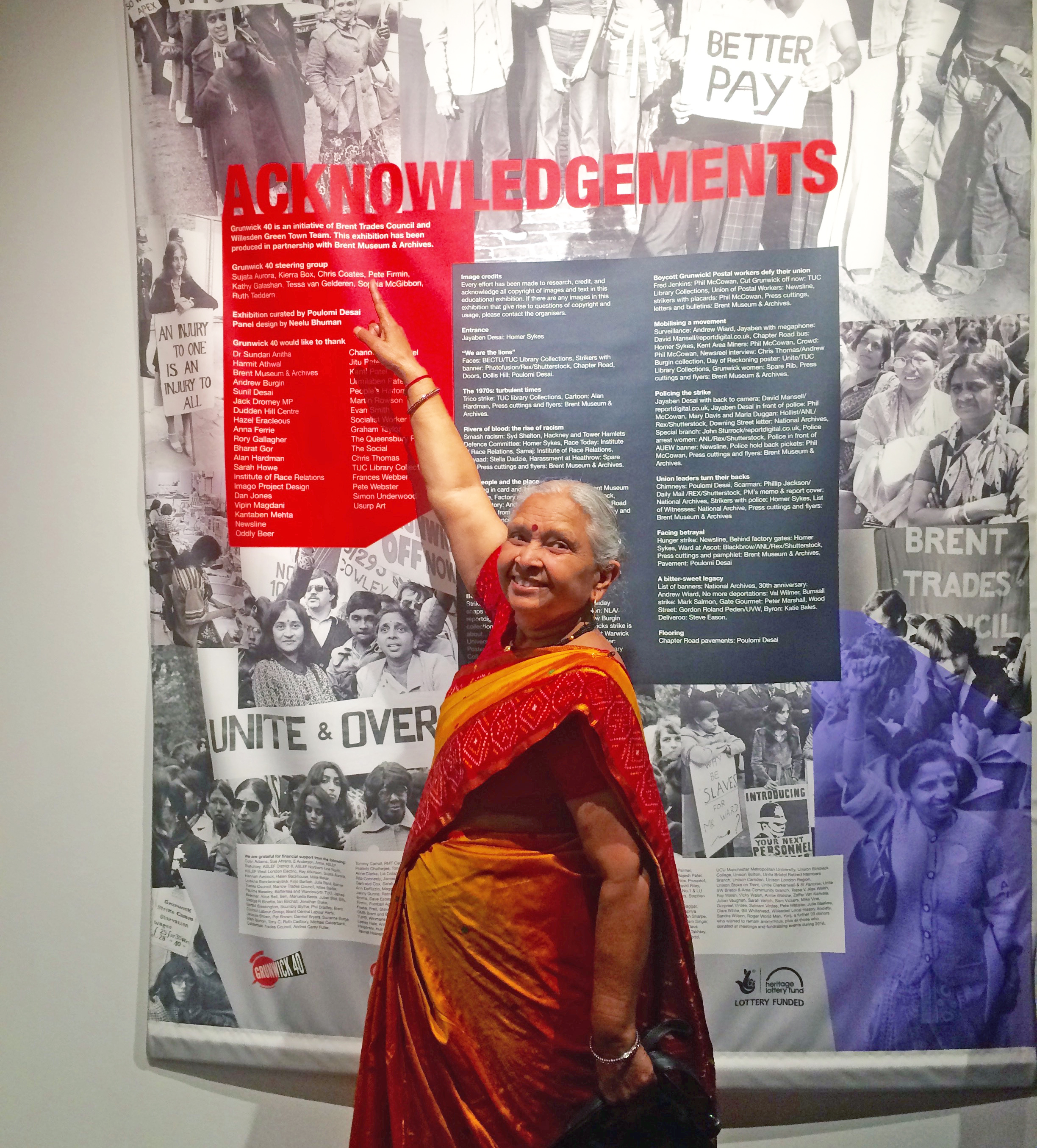 A grunwick striker pointing to an image of herself from the strike.