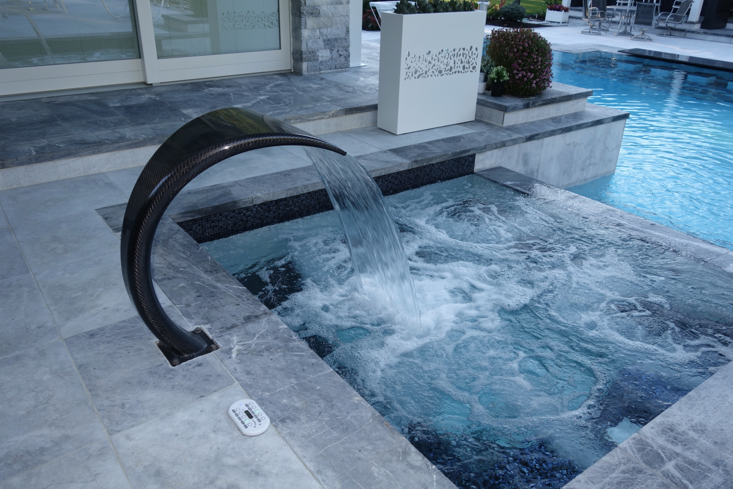 Platinum Group - offering Landscaping in Long island, NY - integrates wellness features into their gunite pools and spas.