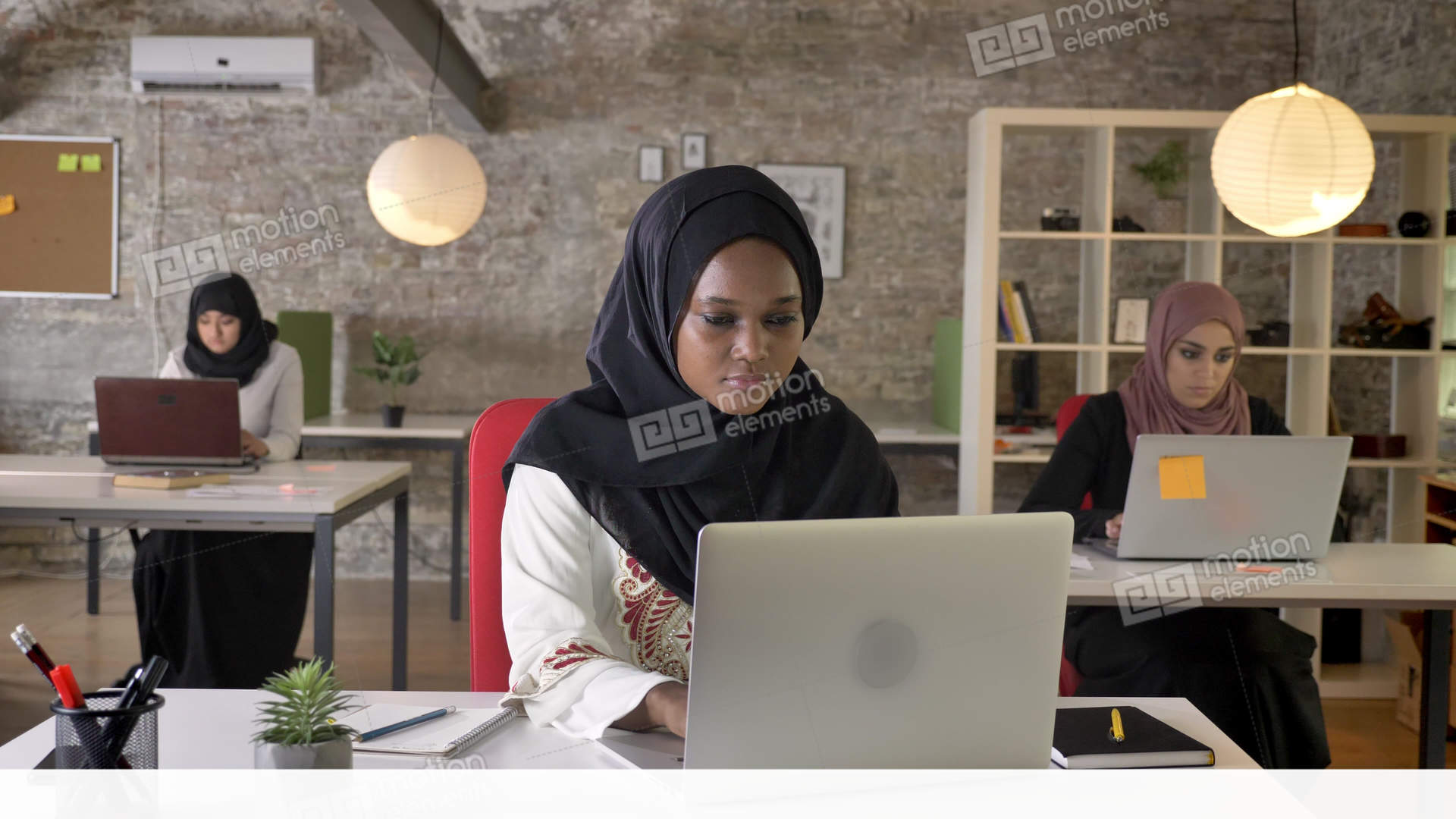 Young Muslim Woman at work.jpg