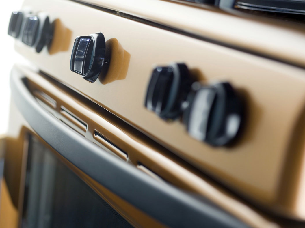 TRG image of dials on a stove.