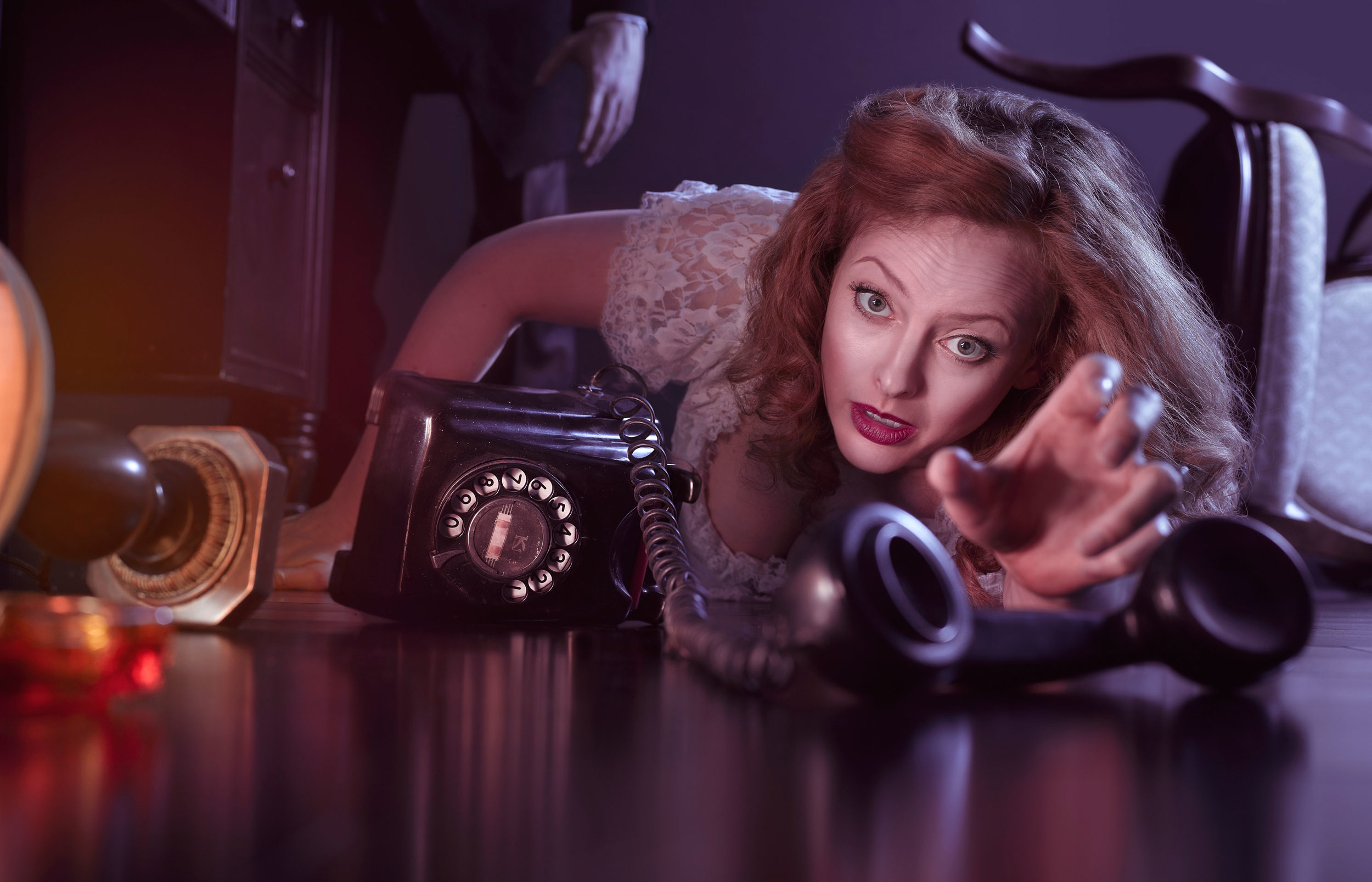 professional photography image of woman on floor reaching for telephone
